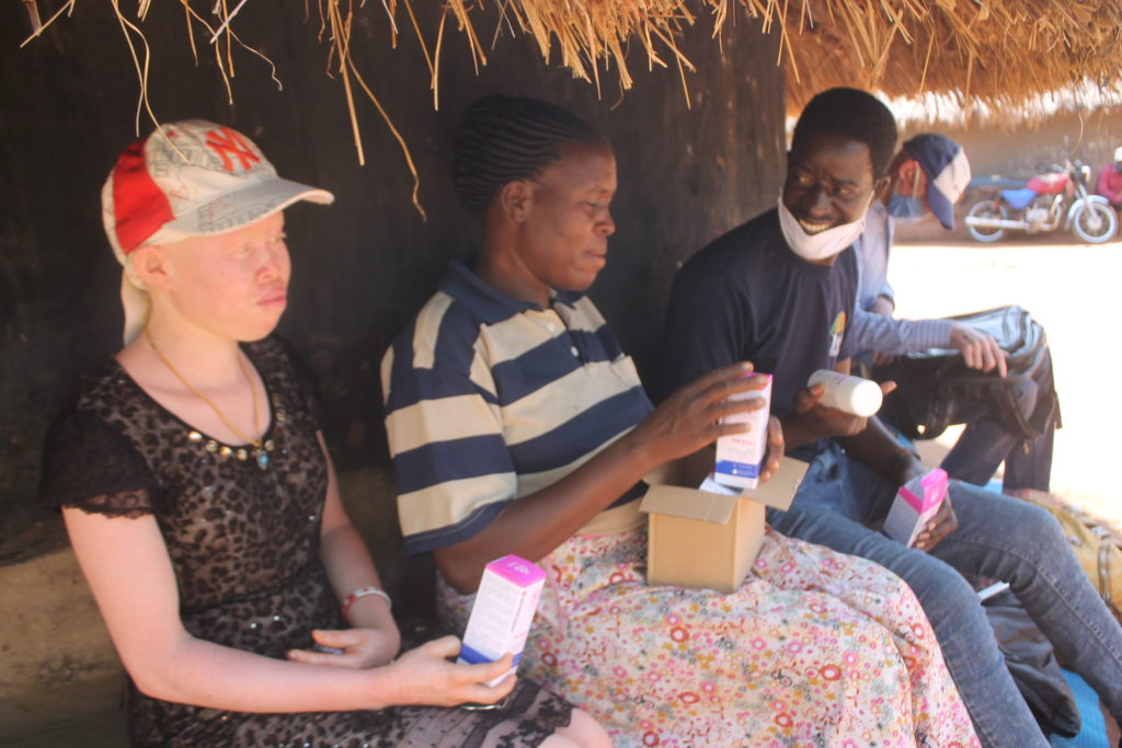 Motorbike mission: Activist delivers sunscreen to Ugandans with albinism